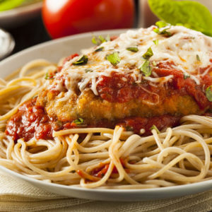 With spaghetti, lightly breaded chicken breast, marinara sauce and melted mozzarella cheese on top