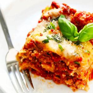 Seasoned ground beef, herbs, layered with ricotta and mozzarella cheese, marinara sauce